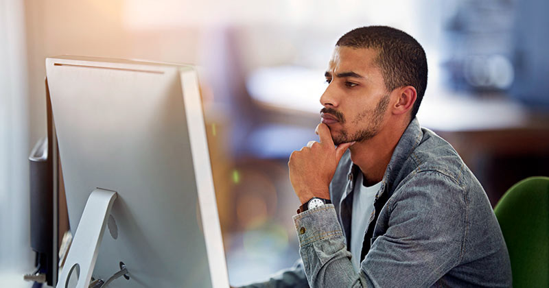 Online MBA student looking at large screen
